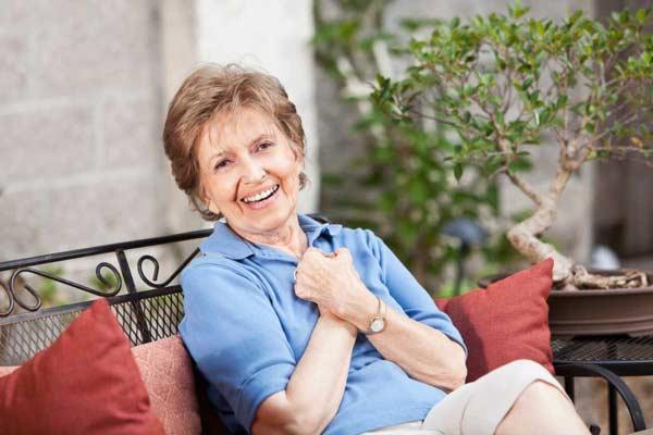 Senior woman smiling at retirement home