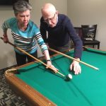 Playing pool at Kingsway Aurora Retirement Residence