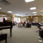 Listening to music at Kingsway Aurora Retirement Residence