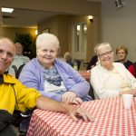 Car show attendees at Kingsway Aurora Retirement Residence