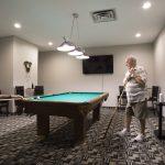 Seniors billiards at Kingsway Aurora Retirement Residence