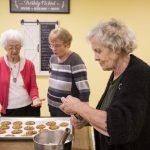 Seniors baking cookies at Kingsway Aurora Retirement Residence