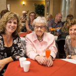 Mother and daughters at Kingsway Aurora Retirement Residence