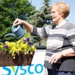 Watering plants at Kingsway Aurora Retirement Residence
